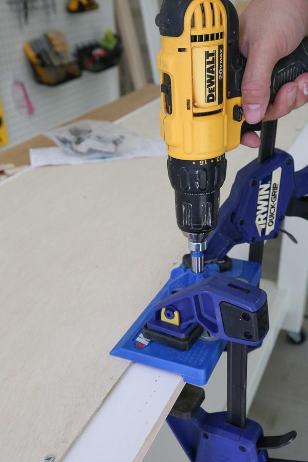 using kreg concealed door hinge jig to drill hinge holes on cabinet door