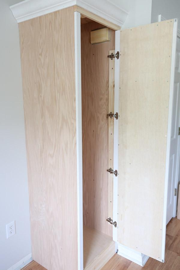 four inset european door hinges installed on DIY built in cabinet door