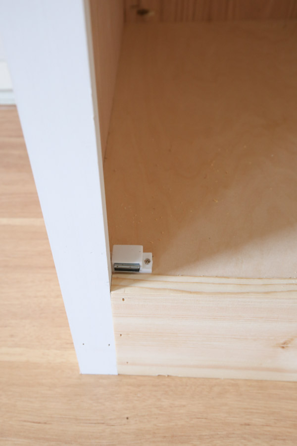 magnetic catch added to built in cabinet door