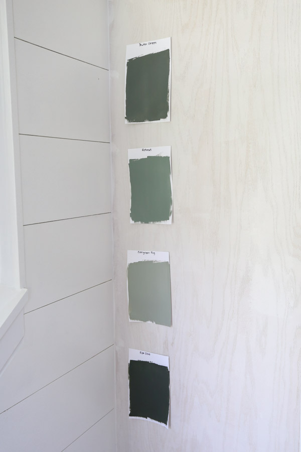 Paint samples of Sherwin Williams pewter green, retreat, evergreen fog and ripe olive