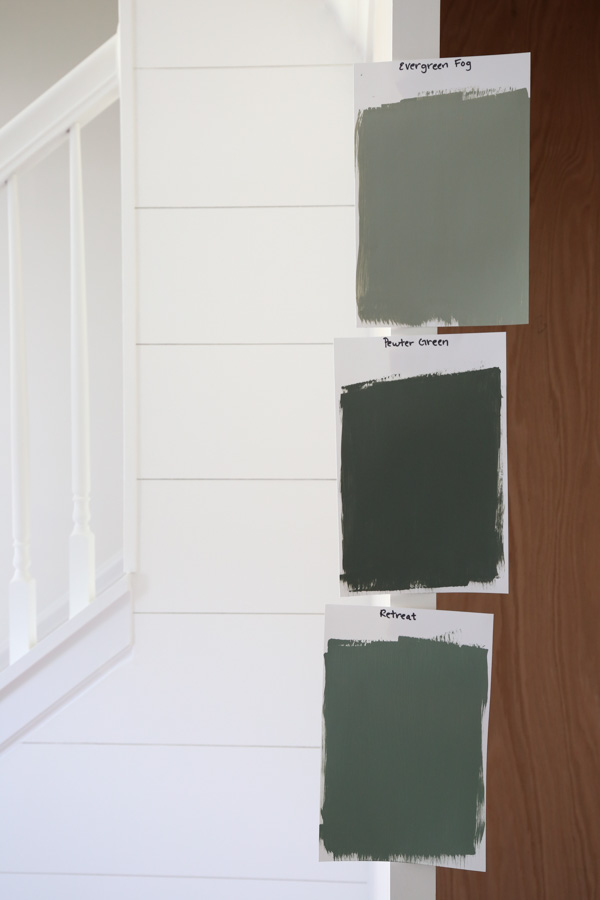 Paint samples of Sherwin Williams pewter green, retreat, and evergreen fog