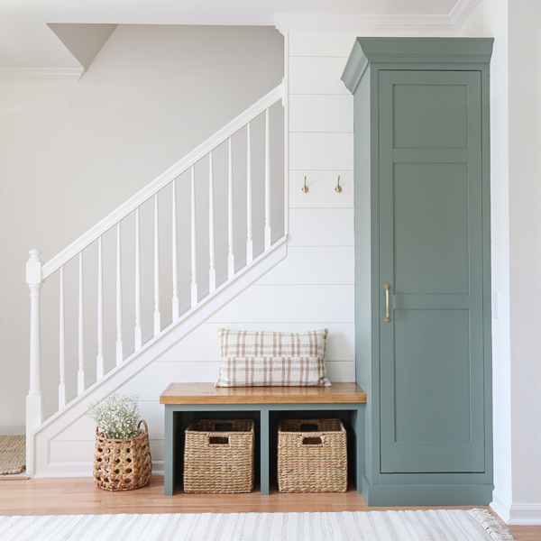 DIY entryway makeover with wood stained built in bench and built in cabinet  painted Sherwin Williams Retreat