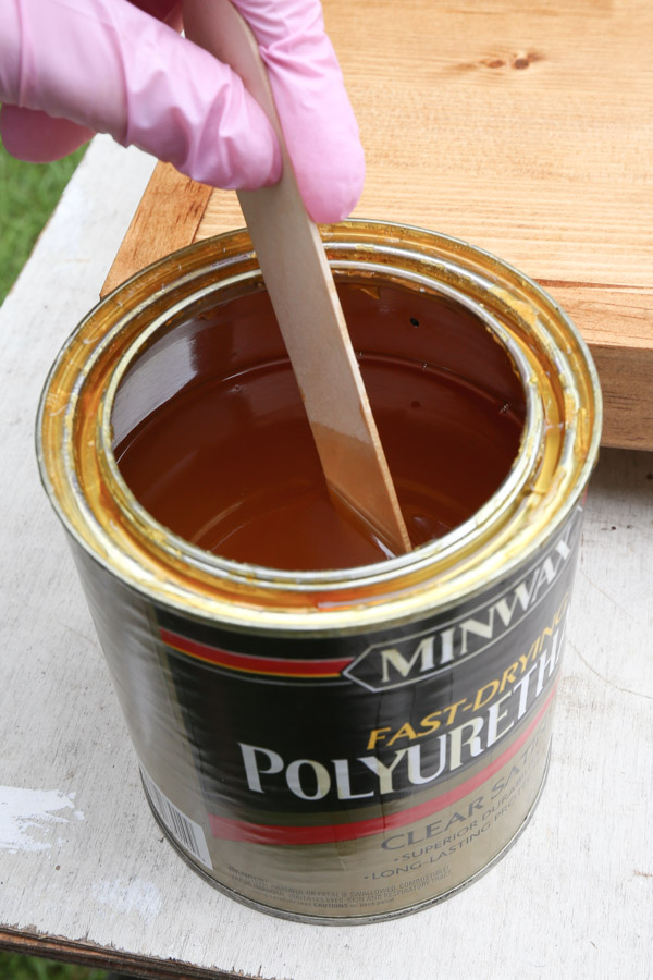 using wood craft stick to stir polyurethane before using and wearing nitrile gloves