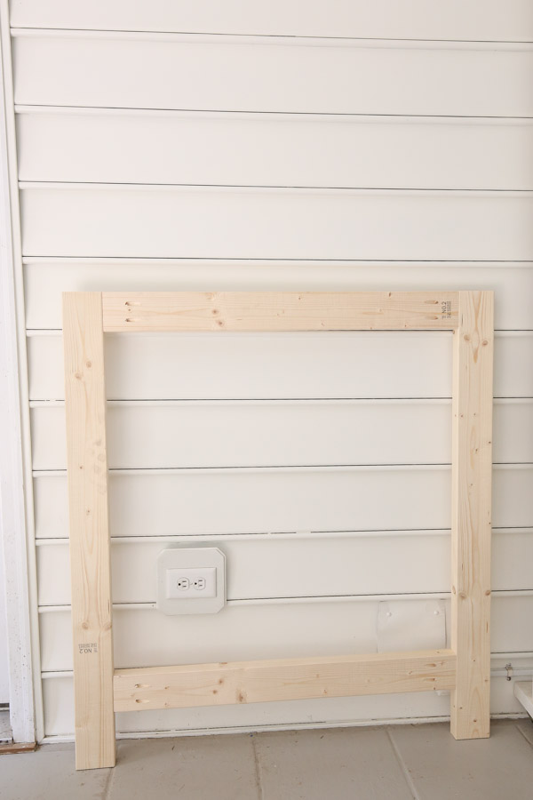 back frame of fireplace made with 2x4s