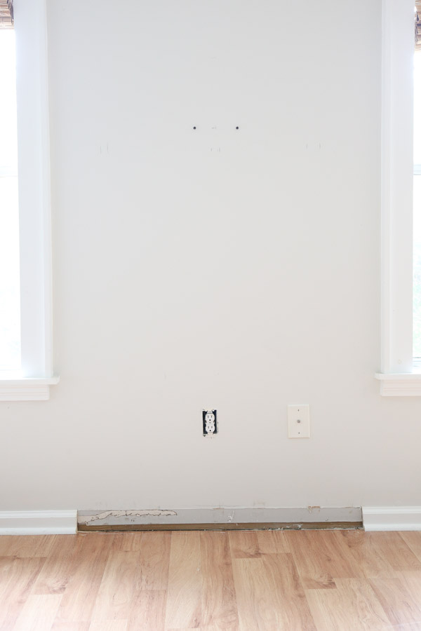 baseboard removed from wall for DIY fireplace install