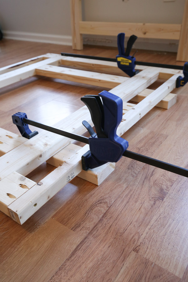 attaching front frame together with clamps and screws