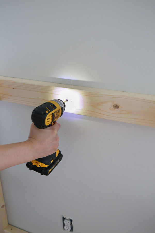 attaching fireplace frame to wall studs with screws