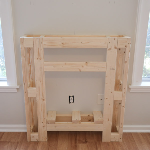 2x4 middle support boards installed on DIY electric fireplace surround