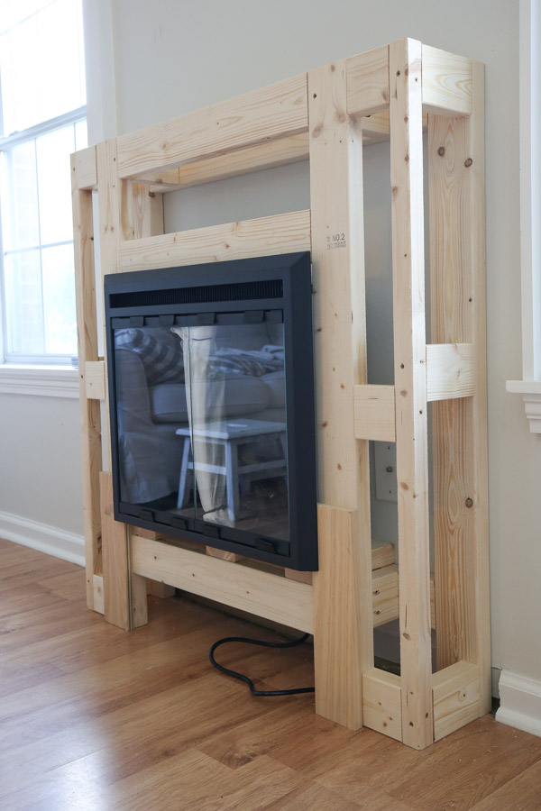 testing the fit of the electric fireplace in the DIY electric fireplace surround