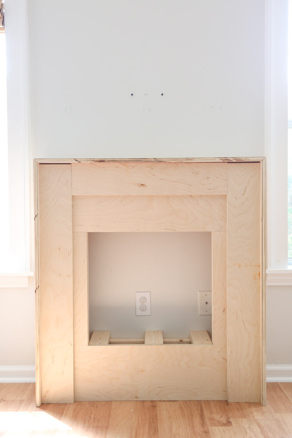 second layer of plywood installed on DIY fireplace frame