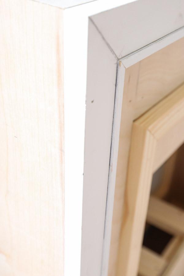 edge of trim on fireplace that needs sanding