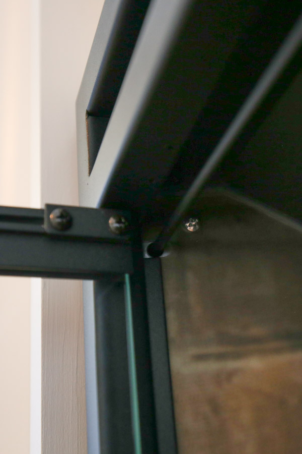 screw for securing electric fireplace insert into DIY fireplace surround