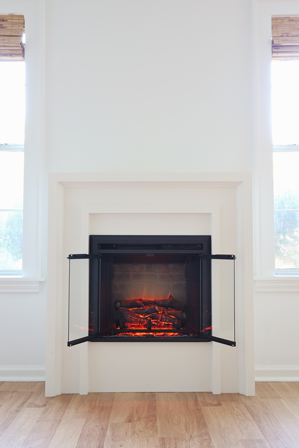 diy fireplace in morning light with electric fireplace insert